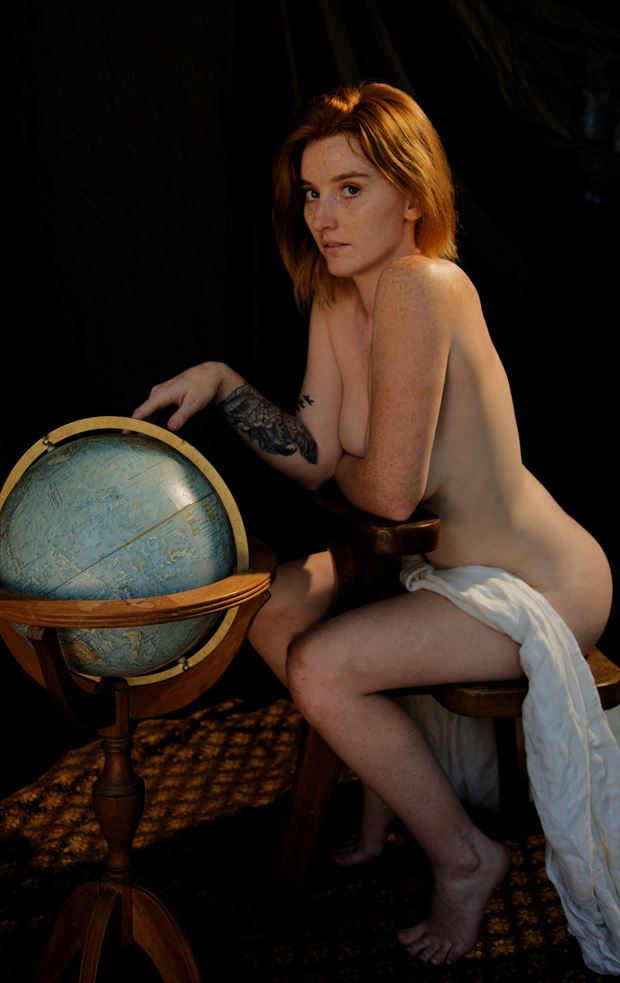 seated nude with globe miss a artistic nude photo by photographer fred scholpp photo