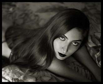 Aida on the Bed Expressive Portrait Photo by Photographer R. Michael Walker