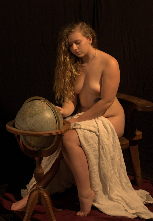 April Studies the Globe Artistic Nude Photo by Photographer Fred Scholpp Photo