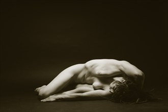 As the Female Relaxes Artistic Nude Photo by Photographer Mark Bigelow