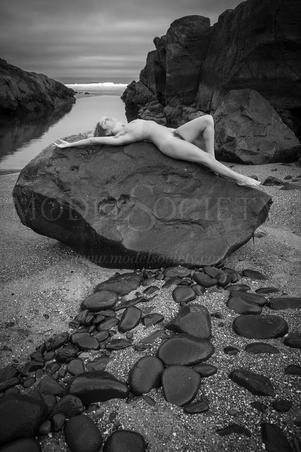 Black Rock Reclined Artistic Nude Photo by Photographer Inge Johnsson
