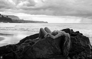 Lying among the rocks and surf  Artistic Nude Artwork by Photographer Thom Peters Photog