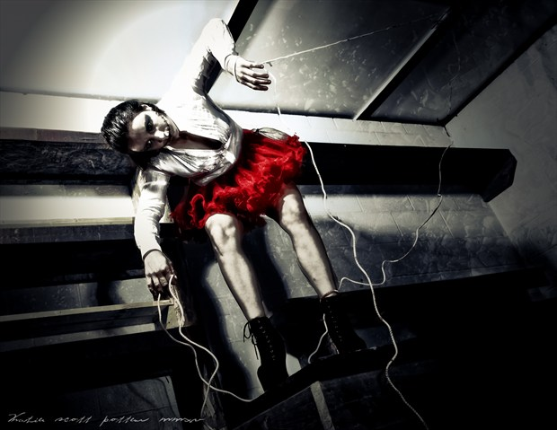 Sinister Puppetry  Surreal Photo by Photographer Katie Potter