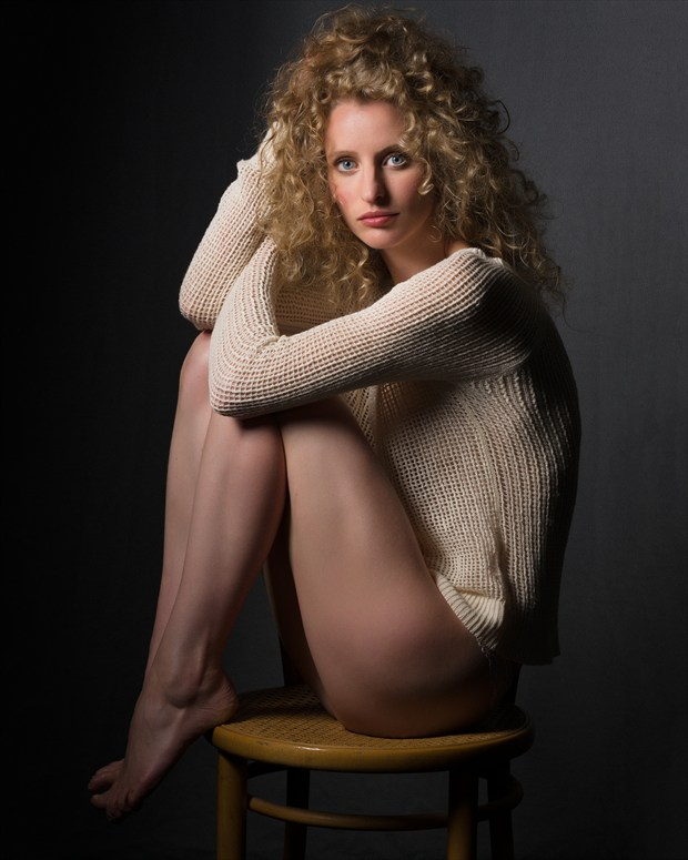 Woman seated on a bamboo chair Expressive Portrait Photo by Photographer Bruce M Walker
