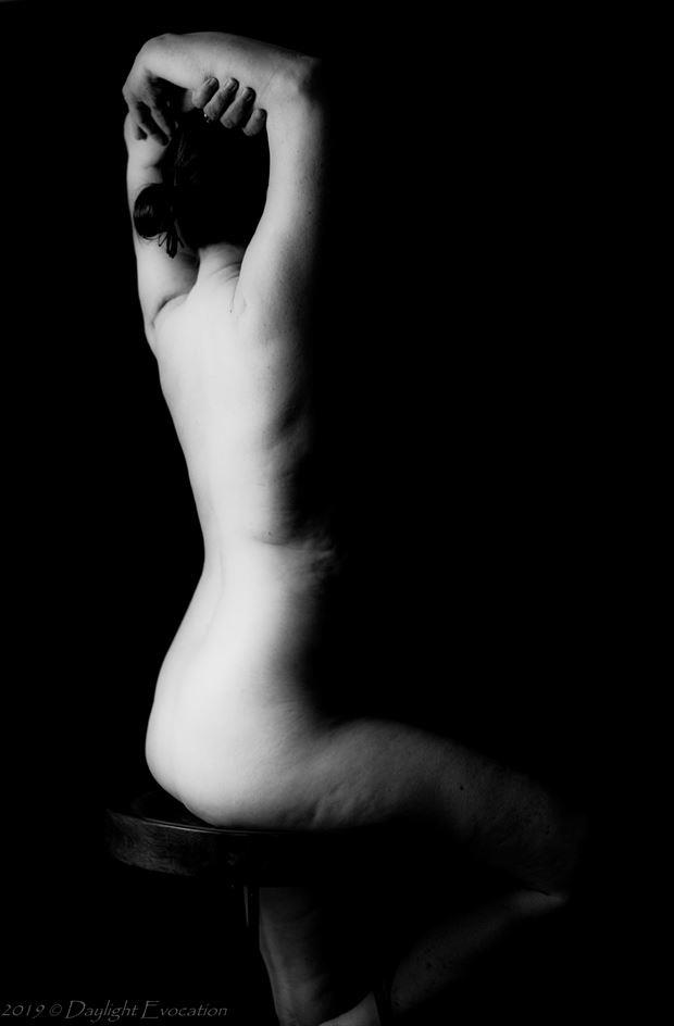 a back is light in the dark artistic nude photo by photographer daylight evocation