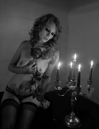 a candle is at its brightest in the dark chiaroscuro photo by photographer anchorphoto