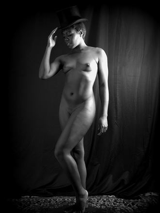 a proper tilt of the hat artistic nude photo by model freedomwingsblazing