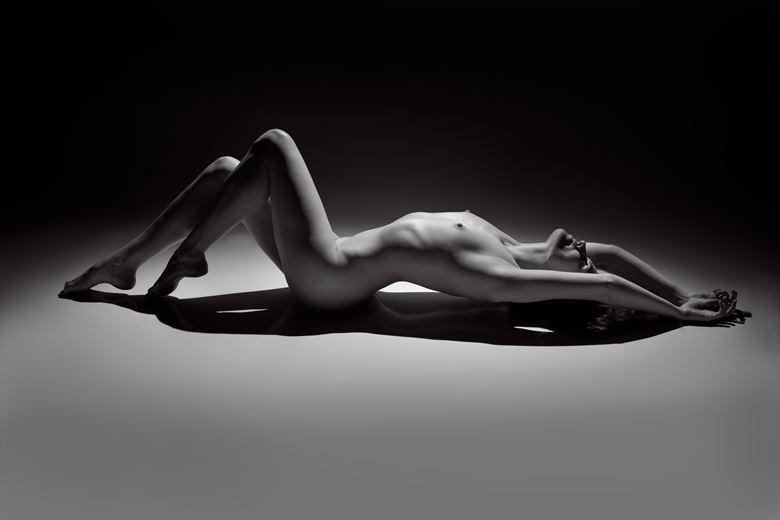 artistic nude studio lighting photo by photographer under black light