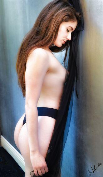 bella against the wall lingerie artwork by photographer jon lecoultre