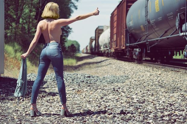 catching the train implied nude photo by model cali laine
