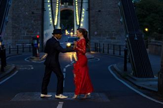 dancing upon the bridge stopping traffic sensual photo by model matriix