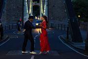 dancing upon the bridge stopping traffic sensual photo by model matriix