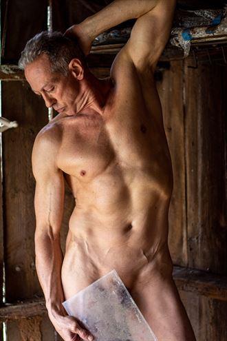 dimly lit shed artistic nude photo by model artfitnessmodel
