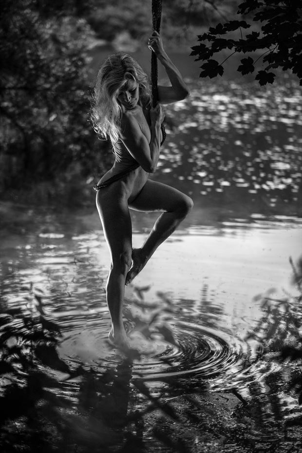 dipping her toe in the water artistic nude photo by model helen saunders