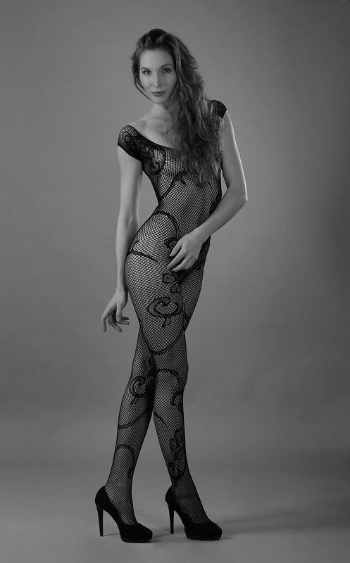 frivolous fishnet fashion sensual photo by photographer anders bildmakare