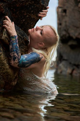 from water she rise tattoos photo by model trasselzudd