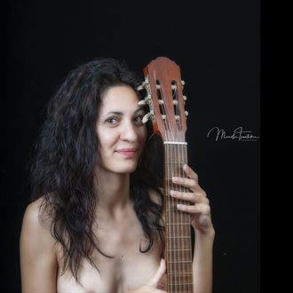 girl with guitar artistic nude photo by photographer manolis tsantakis