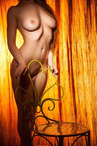 green iron chair artistic nude photo by photographer joe klune fine art