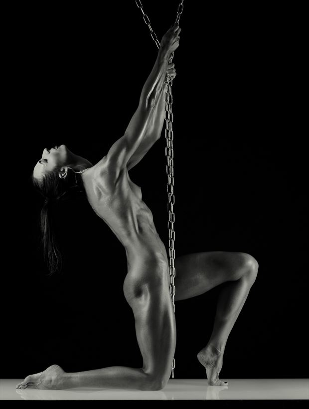 hanging and slipping artistic nude photo by model bia