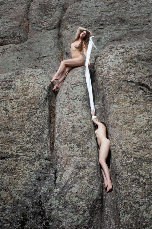hanging from the ledge artistic nude photo by photographer greg holden