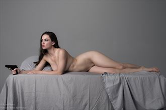 january in a femme fatale pinup pose artistic nude photo by photographer xenophoto