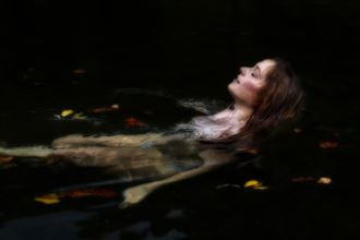 jessie swimming in water with leaves artistic nude photo by photographer daniel l friend