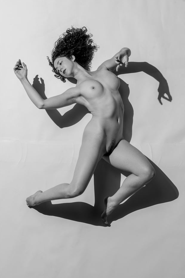 light and shadow artistic nude photo by model her stillness dances