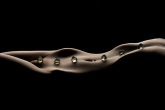 long waves with stones artistic nude photo by photographer musingeye