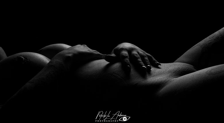 lying in the dark artistic nude artwork by photographer patrik andersson