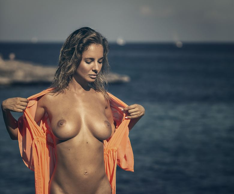 natali on the cliffs artistic nude artwork by photographer dieter kaupp
