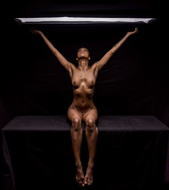 reaching for the light artistic nude photo by photographer paul archer