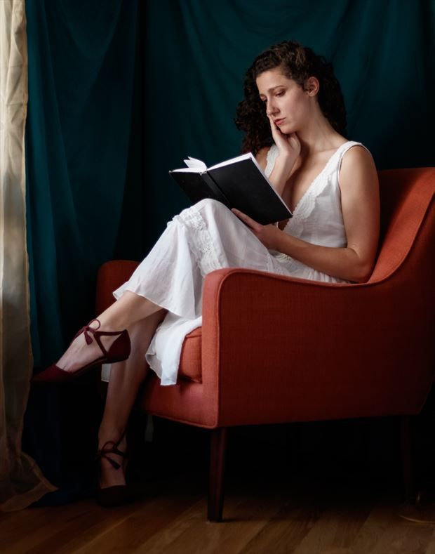 reading a book by sunlight portrait photo by photographer tom branch