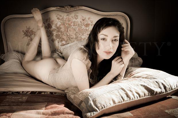 rebecca lies face down on the french bed lingerie photo by photographer ian cartwright