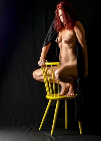 reflecting on one yellow chair artistic nude photo by model tigg