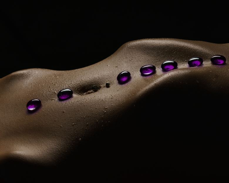 resting stones artistic nude photo by photographer john dunkelberg