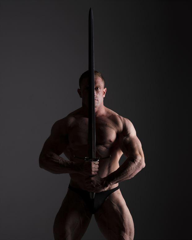singular sword studio lighting photo by photographer john dunkelberg