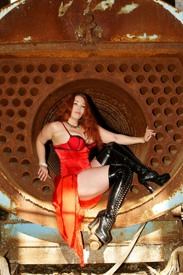 sitting inside of a industrial boiler glamour photo by photographer csdewittphotography