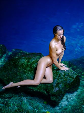 statuesque in front of the blue water of a mexican cenote artistic nude photo by photographer colinwardphotography