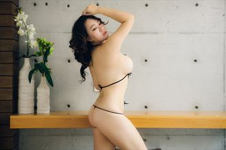 studio lighting implied nude photo by model julie
