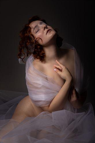 studio lighting implied nude photo by model ophelia elysian