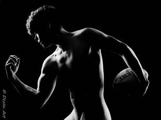 the silhouette of the Rugby player Chiaroscuro Photo by Photographer DEZAU