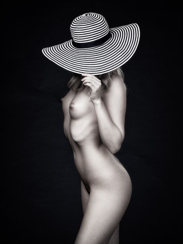 under her hat artistic nude photo by photographer paul mason