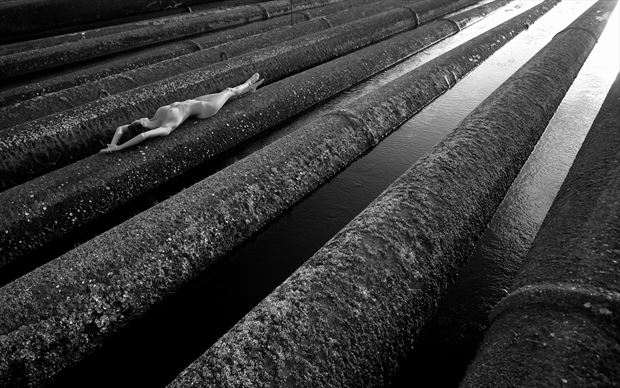 woman on rusty industrial dredging pipes artistic nude photo by photographer bradmiller