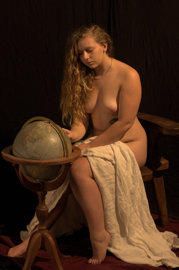 April Studies the Globe Artistic Nude Photo print by Photographer Fred Scholpp Photo