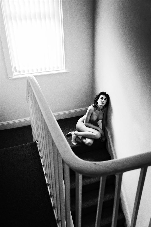 Crouched at the Top of the Stairs Artistic Nude Photo print by Photographer Ian Cartwright