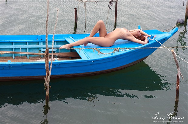 Daniela and the blue boat Artistic Nude Photo print by Photographer Luigi Prearo