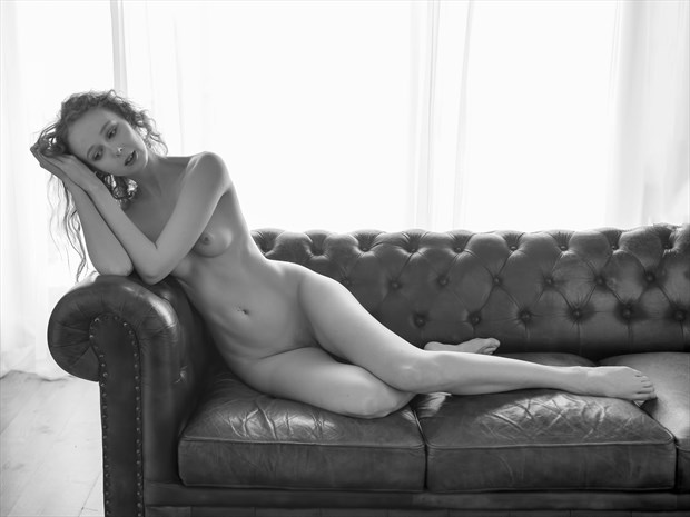 Gemma on the Couch 1 Artistic Nude Photo print by Photographer John Logan