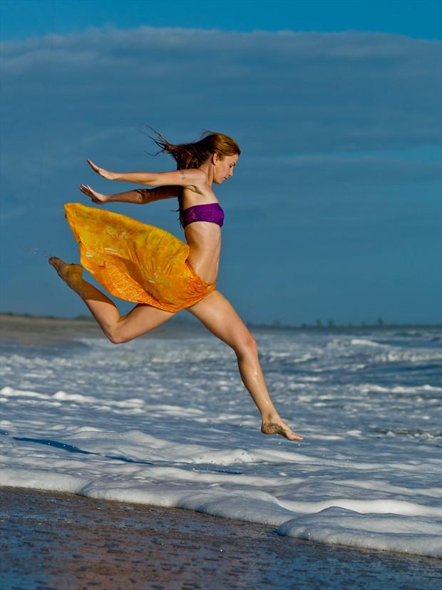 Leaping into the Sea Bikini Photo print by Photographer RobertS