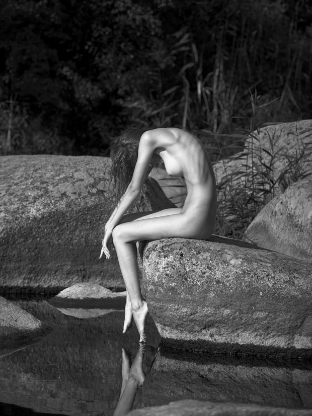 Rocks Artistic Nude Photo print by Photographer Andrey Stanko