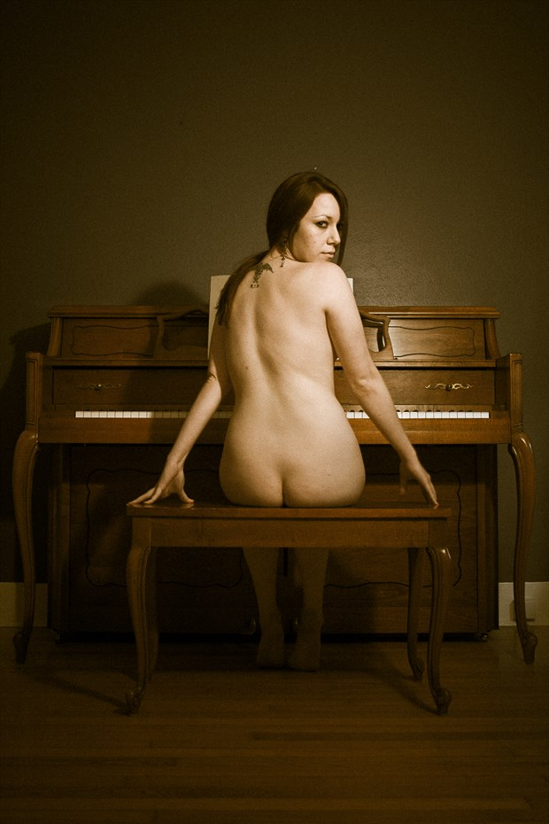 Woman at the piano Artistic Nude Photo print by Photographer Frisson Art